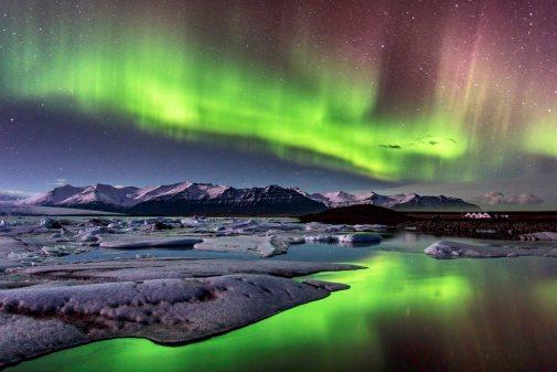Intense Aurora Borealis lights (polar lights) over the glacier lagoon, Jokulsarlon, on Iceland.